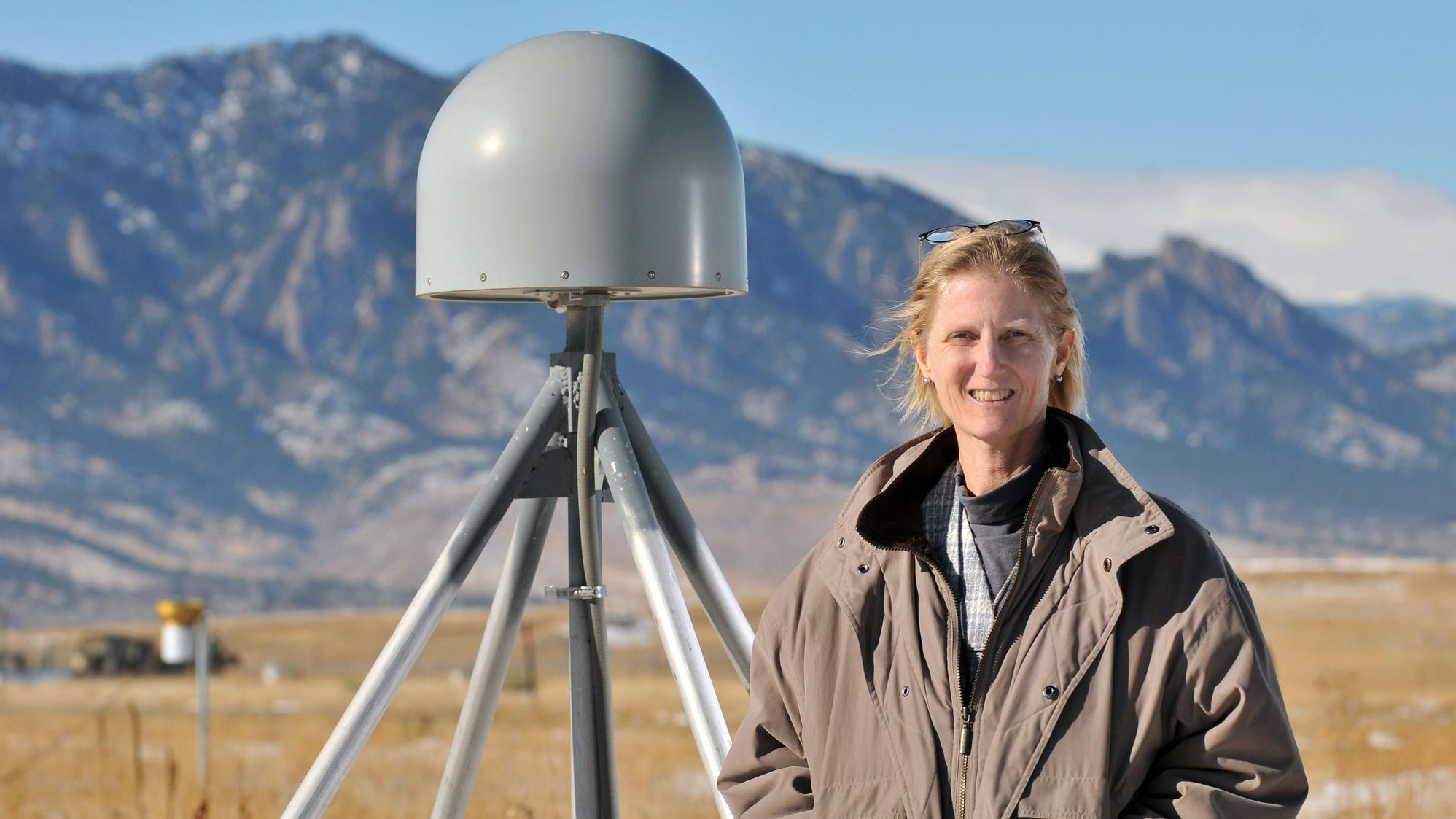 Dr. Kristine M. Larson in front of her favorite GPS site (P041) near Boulder, Colorado. The gray object next to Dr. Larson is a GPS receiver antenna. Photograph by Glenn Asakawa, University of Colorado. Dr. Kristine M. Larson, Professor of Aerospace Engineering Sciences, University of Colorado, Boulder, CO Research interests: Plate tectonics and geodesy, with work developing new ways of using the Global Positioning System (GPS) to study Earth and the water cycle. Research highlights: For many, GPS is a
